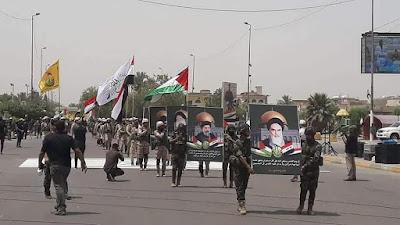 يا للعار . شاهد بالصور صور الخميني وعلم ايران ترفرف في وسط بغداد العروبه .