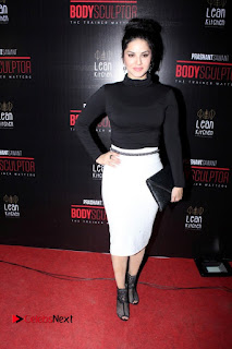 Bollywood Model Actress Sunny Leone Stills in White Skirt at Body Sculptor Gym Launch  0005.jpg