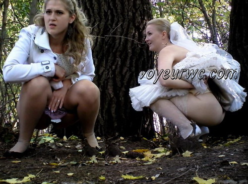 A bride in her wedding dress pissing outdoors with a spy cam observing (Wedding Pissing Park 08)