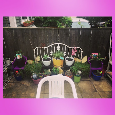 patio fairy garden with upcycled furniture container garden of herbs, flowers and succulents