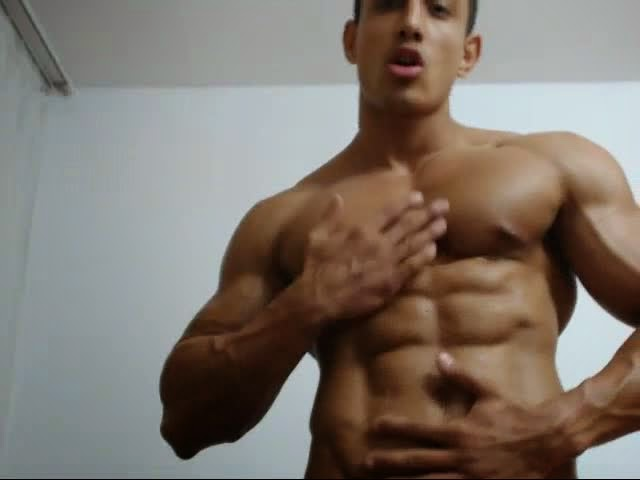 Muscle hunk jerks off on web camera