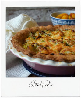 Homity Pie is a simple, homely, and nutritious bake just like a great big hug in pie form!  It is a vegetarian open pie packed with potatoes, spring onions, leeks, and cheese, and is delicious served either with a green salad or a medley of your favourite vegetables.
