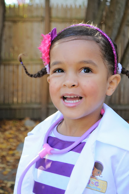 Little girl in doc mcstuffins costume