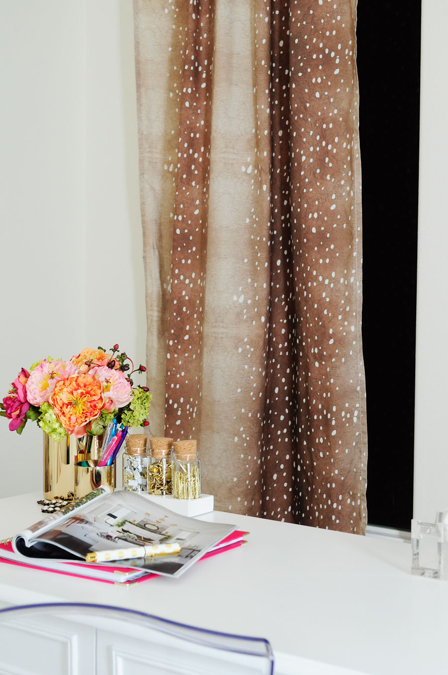 Minted's Trompe L'Oeil Fawn curtains look fabulous in this chic white and gold feminine home office.