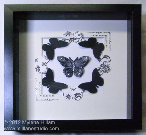 Black and white card stock butterflies framed in a shadow box