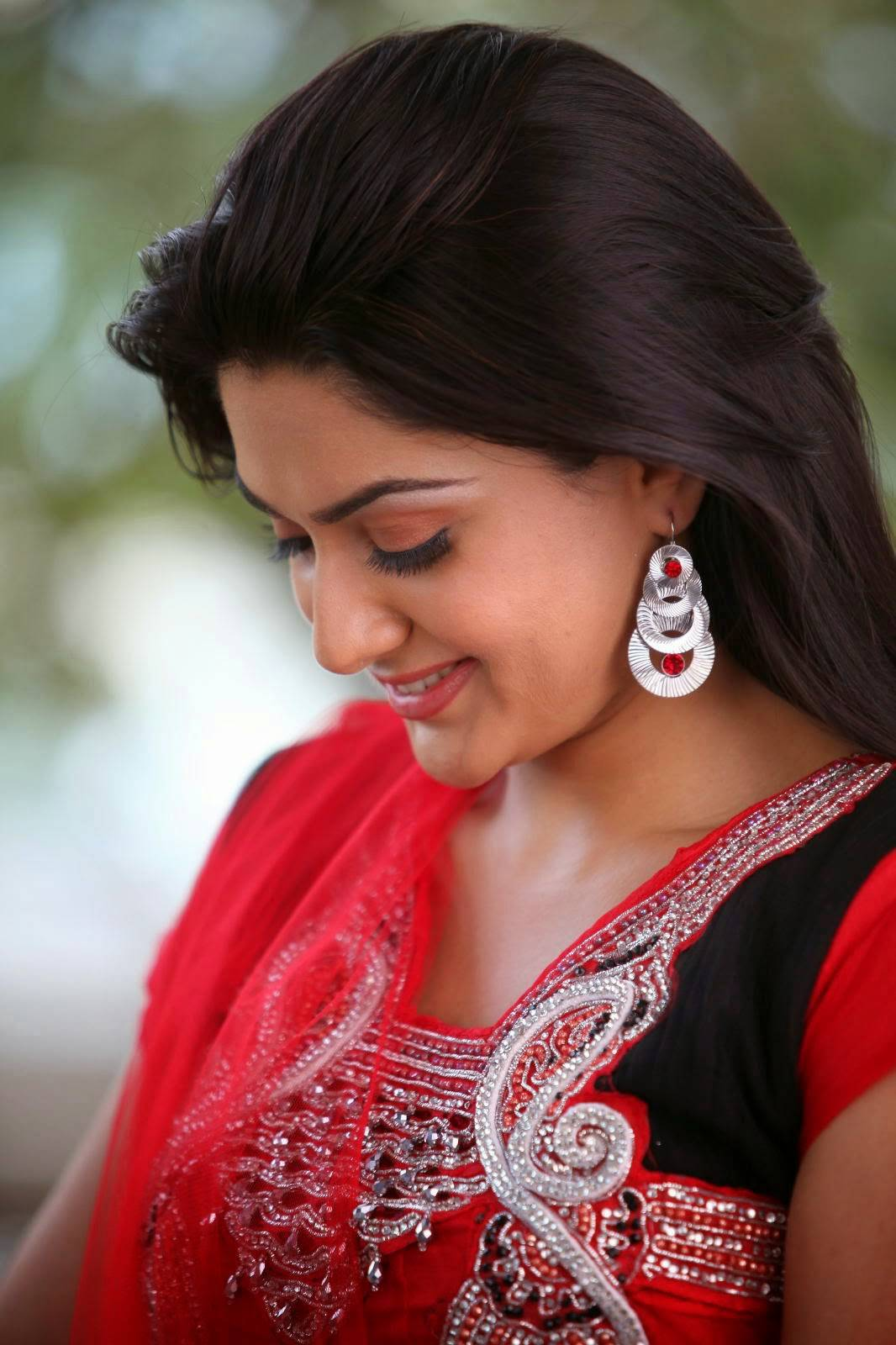 Sakshi Chaudhary Smiling Face Stills In Red Dress