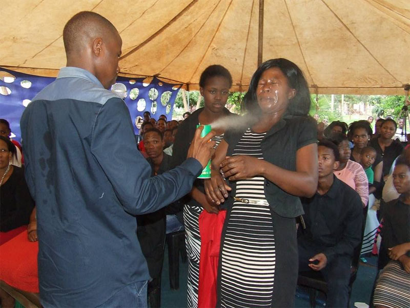 Pastor heals church members by spraying insecticide on them (photos)