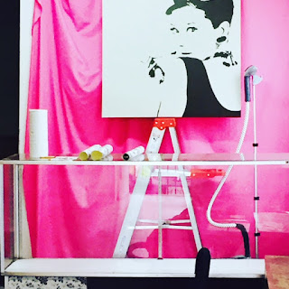Our back wall covered in pink fabric and Audrey Hepburn!