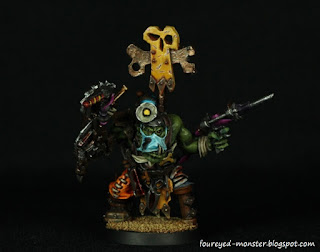 http://foureyed-monster.blogspot.my/2015/10/ork-painboy-of-bad-moonz-clan-completed.html