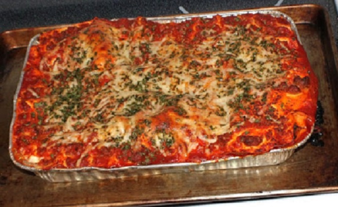This is mom's lasagna usually made on a holiday. It's pasta filled with meat and cheese and baked in a foil pan.