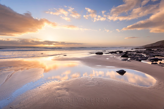The setting sun over Dunraven Bay in South Wales by Martyn Ferry Photography
