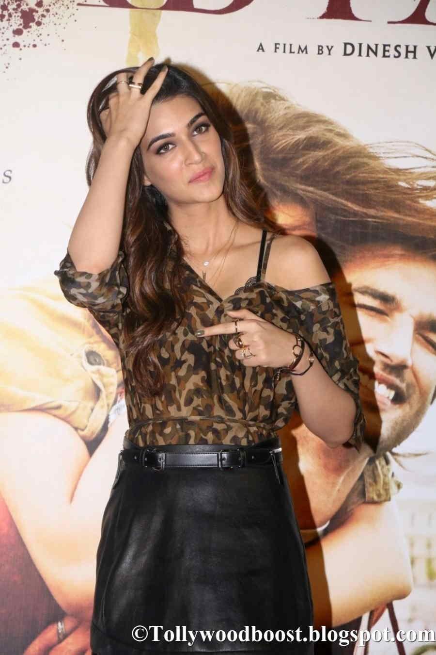 Actress Kriti Sanon Long Legs Thighs Show In Black Mini Dress