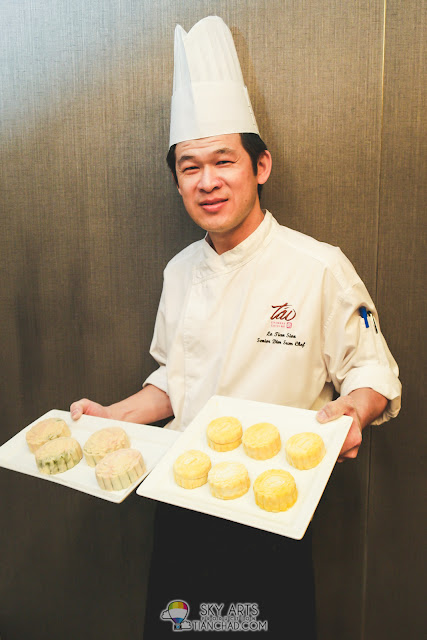 Chef  Lo Tian Sion show the mooncakes that he made (and some that we made)