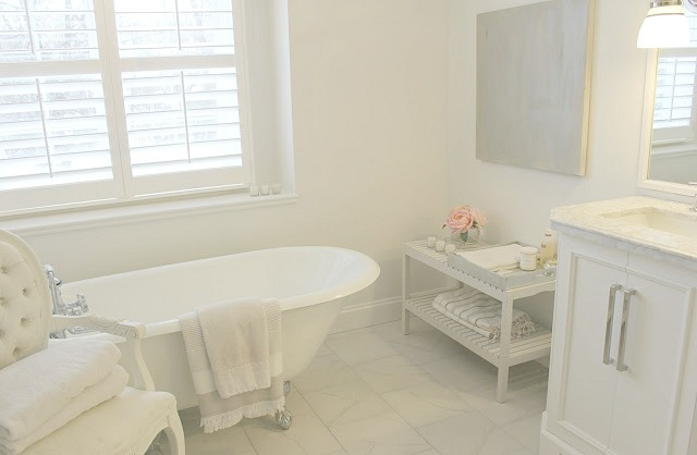 image result for Hello Lovely Studio Chicago fixer upper white master bathroom plantation shutters clawfoot tub Louis chair
