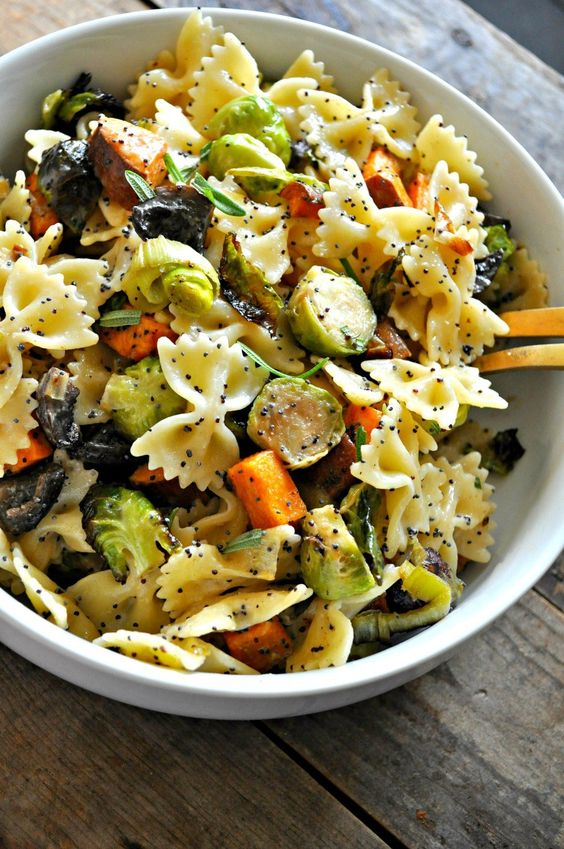 Roasted Fall veggies, tossed with pasta and the most amazing vegan creamy poppy seed dressing!