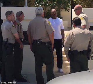 Dr.Dre handcuffed by Malibu police officers