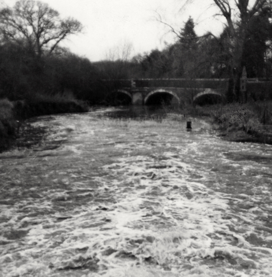 Image: The normally dry river bed from Church Avenue. North Mymms  Image by M Tomkins, from the Peter Miller Collection