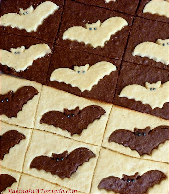 Black and White Brownie Bats, thin chocolate and white chocolate brownies decorated for Halloween. | Recipe developed by www.BakingInATornado.com | #recipe #chocolate #Halloween