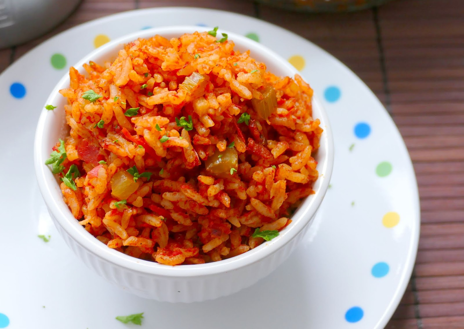 Southern Bacon Red Rice Recipe from Hot Eats and Cool Reads! Everything is better with bacon, especially this traditional southern side dish! Packed with flavor from tomatoes, onion, celery and garlic!