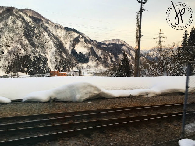 thick snow on the side of train tracks, snowy mountain