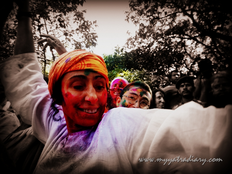A happy lady dancing on the festival of Holi