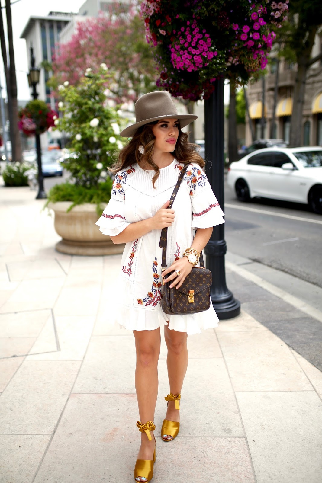 White dress with sleeves, free people fall dress, Louis Vuitton Pochette Metis, Louis Vuitton Pochette Metis fall styled, gold michele watch, gold sam edelman heels, gold wrap heels, janessa leone hat, janessa leone alara hat, hat styled for fall, fall transition outfit, flowy white dress, fall transition dress, affordable white dress, rodeo drive style, top new york city blogger, top nyc blogger, LA blogger, blogger style for fall, long hair style, elle harper, elle harper blog