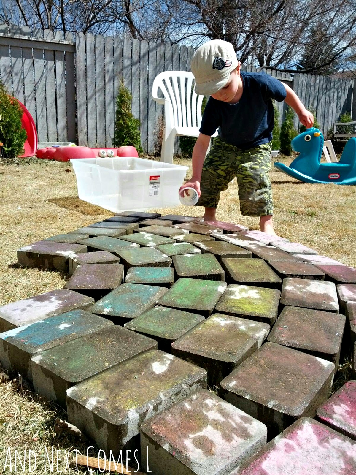 Water play for kids using a giant chalk rainbow from And Next Comes L