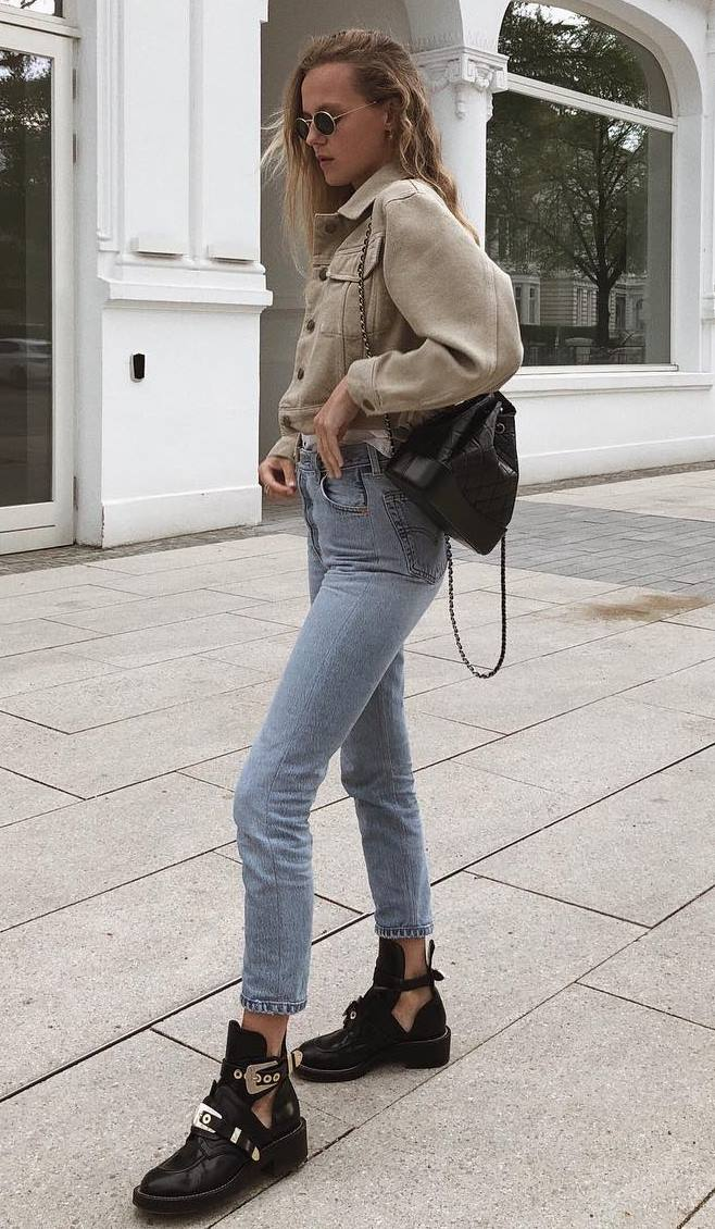 trendy fall outfit / beige jacket + black bag + jeans + boots
