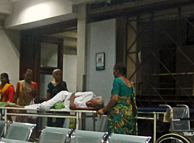 old patient on a stretcher in a hospital