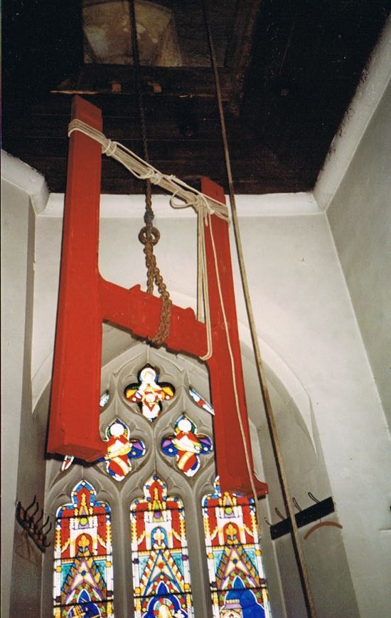 Part of the frame being hoisted through the ringing chamber in 1985  Image by Jane Russell (nee Sherlock) released under Creative Commons BY-NC-SA 4.0