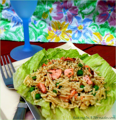 A cool meal for a hot day, Parmesan Balsamic Salmon Salad marries balsamic and parmesan flavors with rice, peas and grilled salmon. | Recipe developed by www.BakingInATornado.com | #recipe #lunch