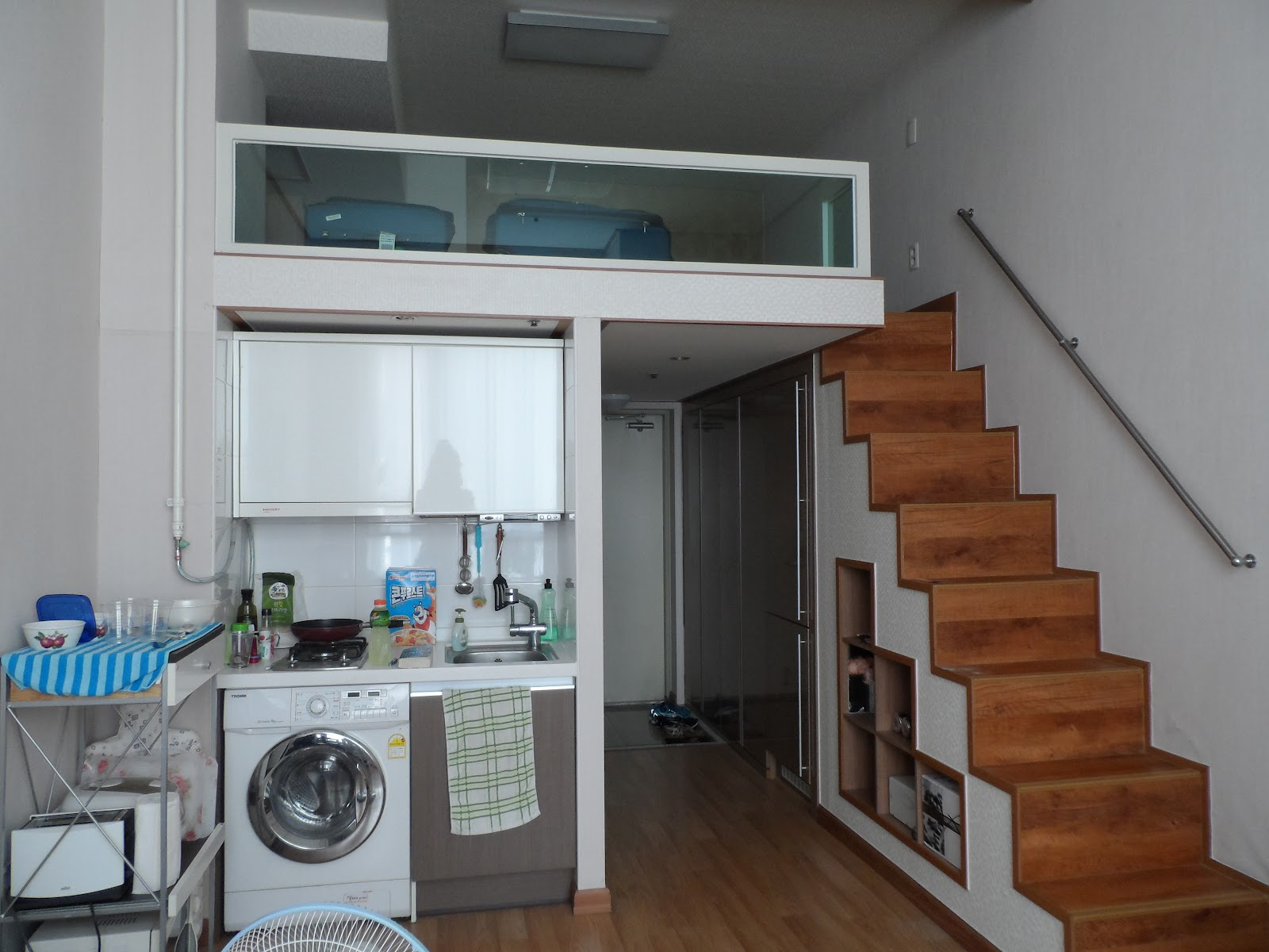 Kitchen On The Left Note Stovetop With A Washing Machine Below No Dryer