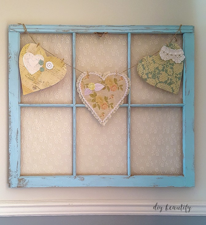 Update an antique window with paint and even lace for a piece that's original and makes a statement! Tutorial available at diy beautify!