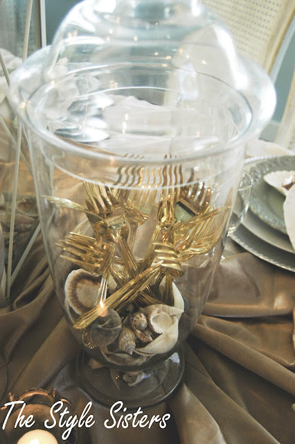 gold forks in apothecary jar