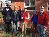 group of gardeners smile at camera