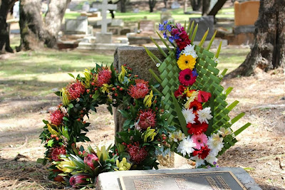 Wreaths on the South Brisbane Cemetery plaque (ASSIS)