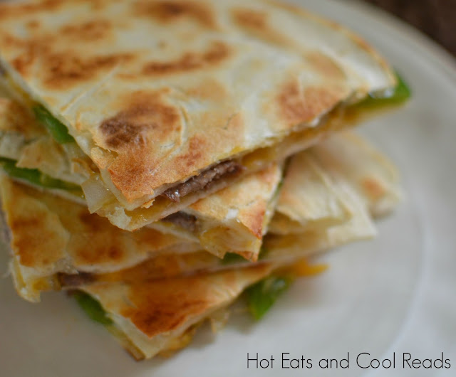 A great game day appetizer or even dinner! So easy and full of cheesy goodness! Philly Cheesesteak Quesadillas Recipe from Hot Eats and Cool Reads
