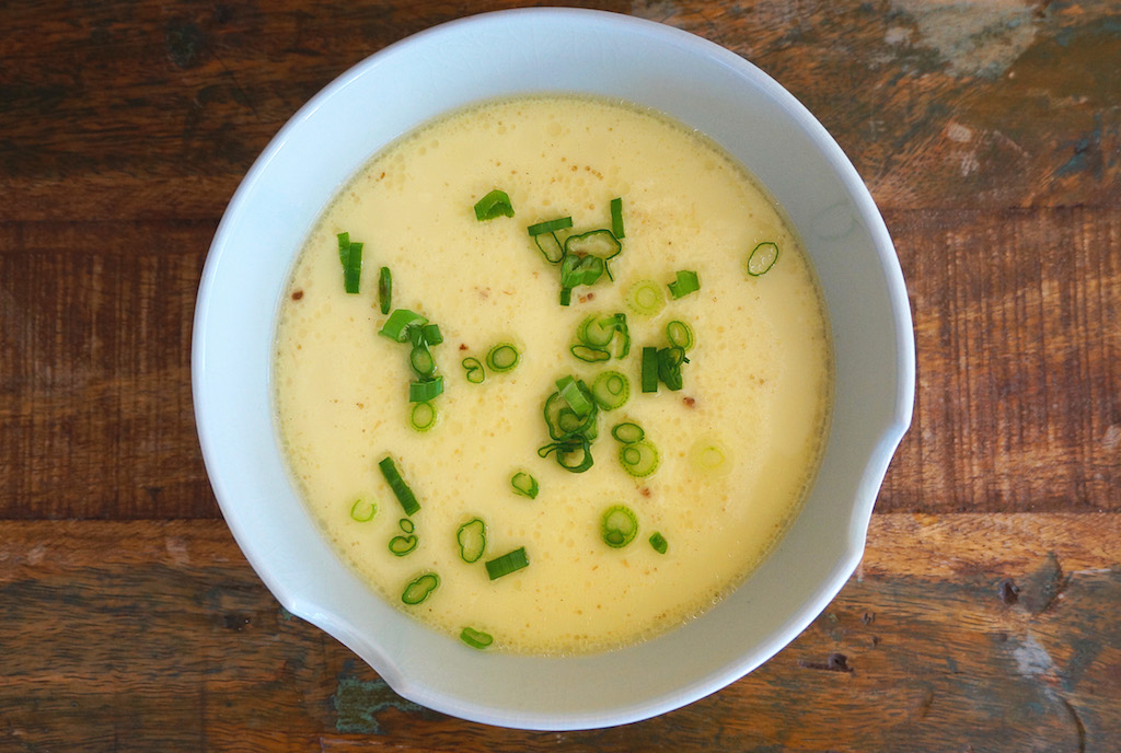 To Serve Top The Steamed Eggs With Some Light Soy Sauce Ground White Pepper And Chopped Scallions