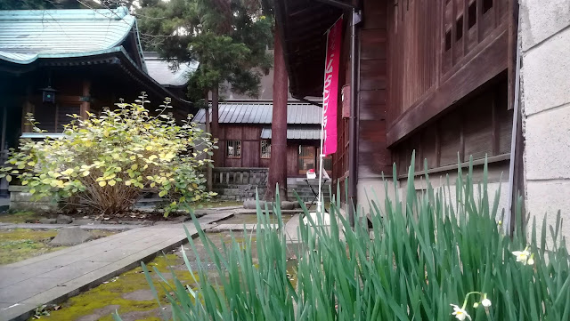 The grounds of Suwadai Shrine. The banner advertises the position of the souvenir stamp table.