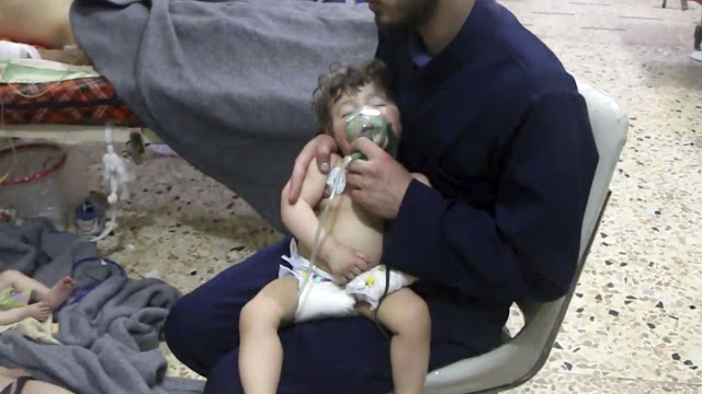 Dozens killed in suspected chemical weapons attack on rebel-held city near Damascus, activists say...