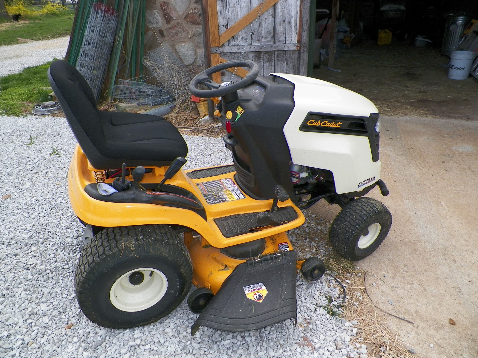 ... Cub Cadet (LTX 1042 KW) because of the features, the engine and the 3  year warranty. Plus, it has a manual deck lift and manual PTO...less to go  wrong.