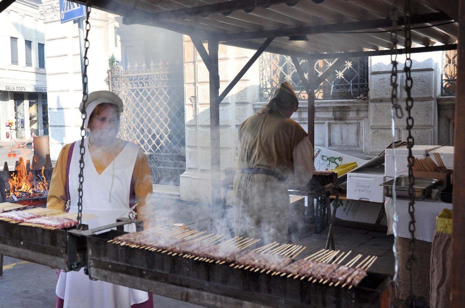 Roasting the Arrosticini Thienesi on hot coals, Thiene, Veneto, Italy
