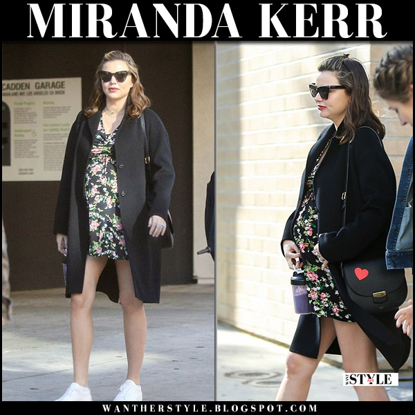 Miranda Kerr in black iris von arnim coat, floral mini dress and white sneakers common projects street fashion baby bump march 25