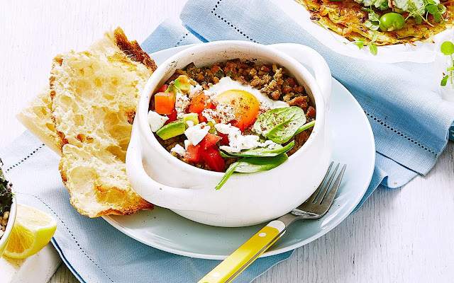 Turkish breakfast with spiced mince and eggs with a peace of bread in a clay pot