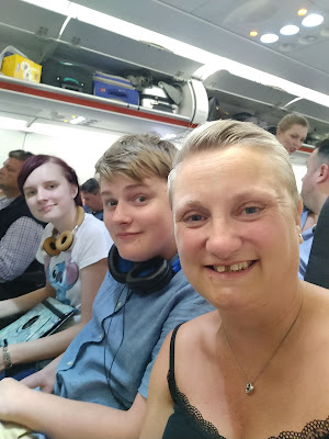 madmumof7 and teens on airplane