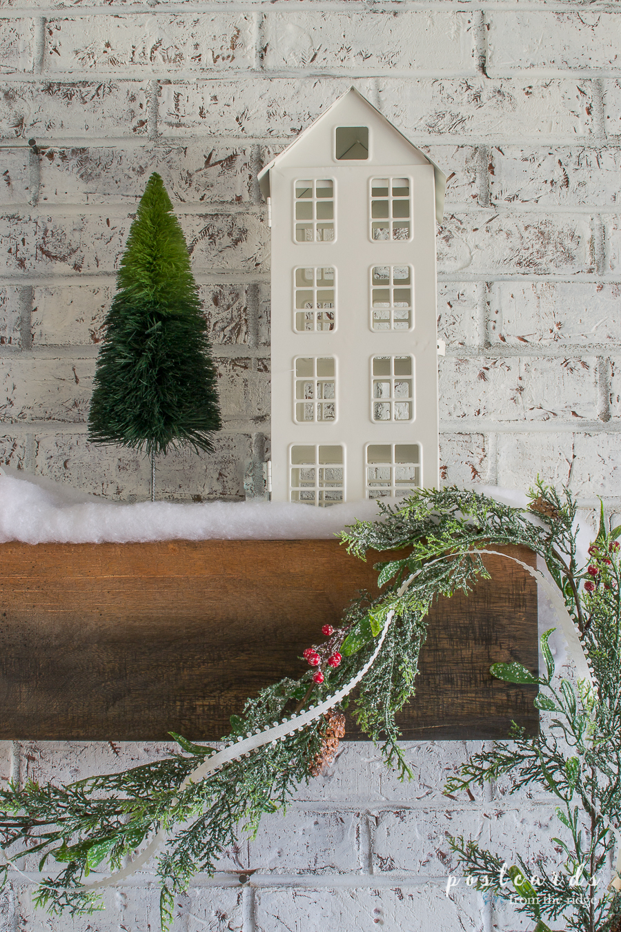 metal house shaped lantern, bottle brush trees, farmhouse mantel