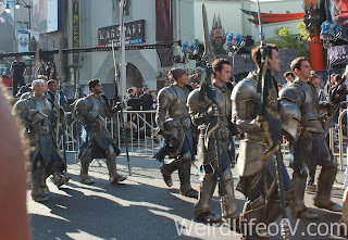 People dressed in armor to stand on the red carpet