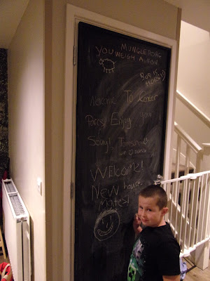 writing rude messages to each other on a blackboard