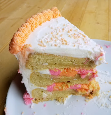 large slice of layered cookie birthday cake