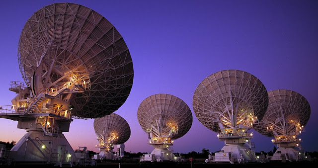 Researchers sent a reference signal between two radio telescopes using a 155-kilometer fiber optic telecommunications link. The new technique passively compensates for network signal fluctuations introduced by environmental factors such as temperature changes or vibrations. Image Credit: D. Smyth, CSIRO.